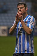 Coventry City defender Chris Stokes applauds the fans  during the Sky Bet League 1 match between Coventry City and Barnsley at the Ricoh Arena, Coventry, England on 3 November 2015. Photo by Simon Davies.