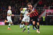 Simon Francis (2) of AFC Bournemouth and Norwich City midfielder Onel Hernandez (25) during the EFL Cup 4th round match between Bournemouth and Norwich City at the Vitality Stadium, Bournemouth, England on 30 October 2018.