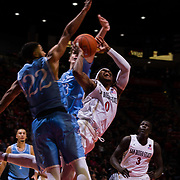 05 December 2018: San Diego State Aztecs guard Devin Watson (0) attempts to drive through two Torero defenders while trailing late in the second half. The Aztecs lost to the Toreros 73-61 at Viejas Arena.