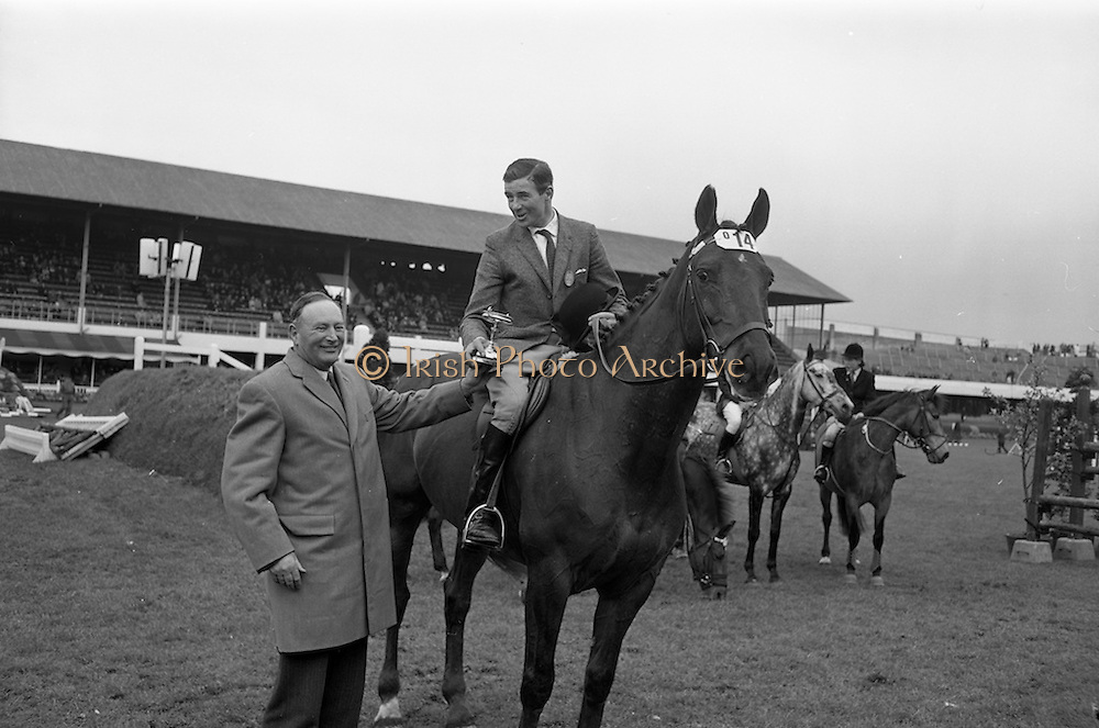 """08/05/1964<br /> 05/08/1964<br /> 08 May 1964<br /> R.D.S. Spring Show Ballsbridge Dublin, Championship Showjumping. Mr. H. Barrington-Jellett (left), President of the R.D.S. presenting the Schwepps Cup to Mr. Seamus Hayes on """"Goodbye"""", winner of Championship Competition """"O"""" at the Dublin Spring Show. """"Goodbye"""" was owned by Mr. Joseph J. McGrath."""