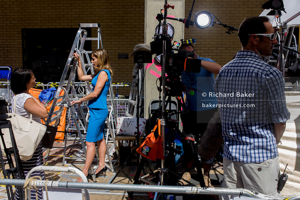 US NBC TV reporter Natalie Morales with technicians reports live for Today from media village behind railings as tension mounts outside St Mary's Hospital, Paddington London, where media and royalists await news of Kate, Duchess of Cambridge's impending labour and birth. Some have been camping out for up to two weeks during a UK heatwave, having bagged the best locations where an heir to the British throne will eventually be shown to the world. Amercian NBC TV correspondent Natalie Morales plus technicians reports live for the Today show from media village behind railings as tension mounts outside St Mary's Hospital, Paddington London. Here, media and royalists await news of Kate, Duchess of Cambridge's impending labour and birth. Some have been camping out for up to two weeks during a UK heatwave, having bagged the best locations where an heir to the British throne will eventually be shown to the world.
