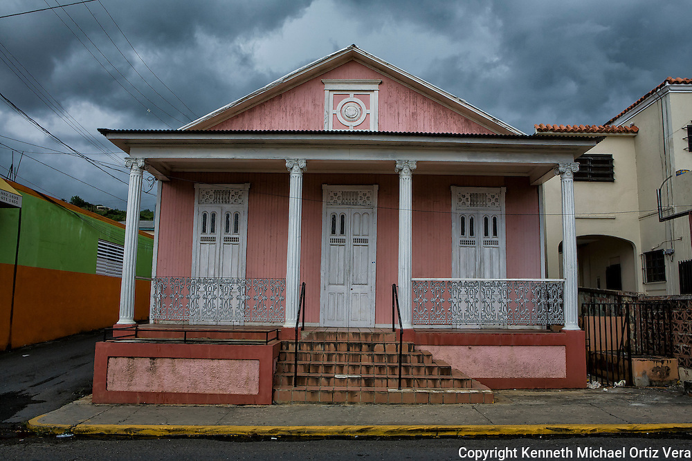 A turn of the century home in Aguadilla Puerto Rico with storm clouds up above.