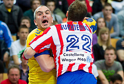 Milorad Krivokapic of Cimos Koper vs Mariusz Jurkiewicz of Atletico Madrid during 1st Leg handball match between RK Cimos Koper and BM Atletico Madrid (ESP) in Quarterfinals of EHF Champions League 2011/2012, on April 21, 2012 in Arena Bonifika, Koper, Slovenia. (Photo by Vid Ponikvar / Sportida.com)