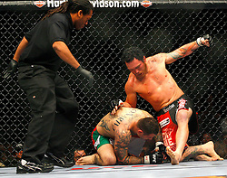 March 1, 2008; Columbus, OH; UFC 82: Pride of a Champion -  Chris Leben (black/red trunks) knocks out Alessio Sakara (red/white/green trunks) in the first round of their bout at the Nationwide Arena in Columbus, OH.