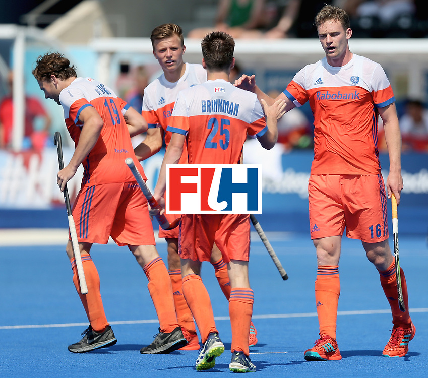 LONDON, ENGLAND - JUNE 19:  Mirco Pruijser of the Netherlands (R) celebrates scoring his teams third goal with teammate Thierry Brinkman of the Netherlands during the Hero Hockey World League Semi-Final match between Netherlands and Canada at Lee Valley Hockey and Tennis Centre on June 19, 2017 in London, England.  (Photo by Alex Morton/Getty Images)