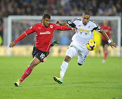 Cardiff City's Fraizer Campbell battles for the ball with Swansea City's Ashley Williams - Photo mandatory by-line: Joe Meredith/JMP - Tel: Mobile: 07966 386802 03/11/2013 - SPORT - FOOTBALL - The Cardiff City Stadium - Cardiff - Cardiff City v Swansea City - Barclays Premier League