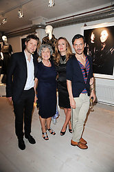 Left to right, CHRISTOPHER BAILEY, JOAN BURSTEIN, LUCY YEOMANS and MATTHEW WILLIAMSON at a dinner hosted by Harper's Bazaar to celebrate Browns 40th Anniversary in aid of Women International held at The Regent Penthouses & Lofts, 16-18 Marshall Street, London on 20th May 2010.