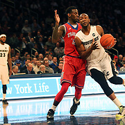 Kadeem Batts, Providence, drives to the basket during the Providence Vs St. John's Red Storm basketball game during the Big East Conference Tournament at Madison Square Garden, New York, USA. 12th March 2014. Photo Tim Clayton
