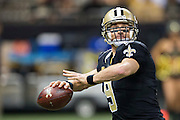 NEW ORLEANS, LA - NOVEMBER 8:  Drew Brees #9 of the New Orleans Saints throws a pass during a timeout against the Tennessee Titans at Mercedes-Benz Superdome on November 8, 2015 in New Orleans, Louisiana.  The Titans defeated the Saints in overtime 34-28.  (Photo by Wesley Hitt/Getty Images) *** Local Caption *** Drew Brees