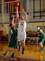 Hopkinton's Jake Nelson attempts to block a shot by Concord's Bakir Bascelic during the semi final game in the Capitol Area Holiday Tournament at NHTI Saturday evening.  (Karen Bobotas/for the Concord Monitor)