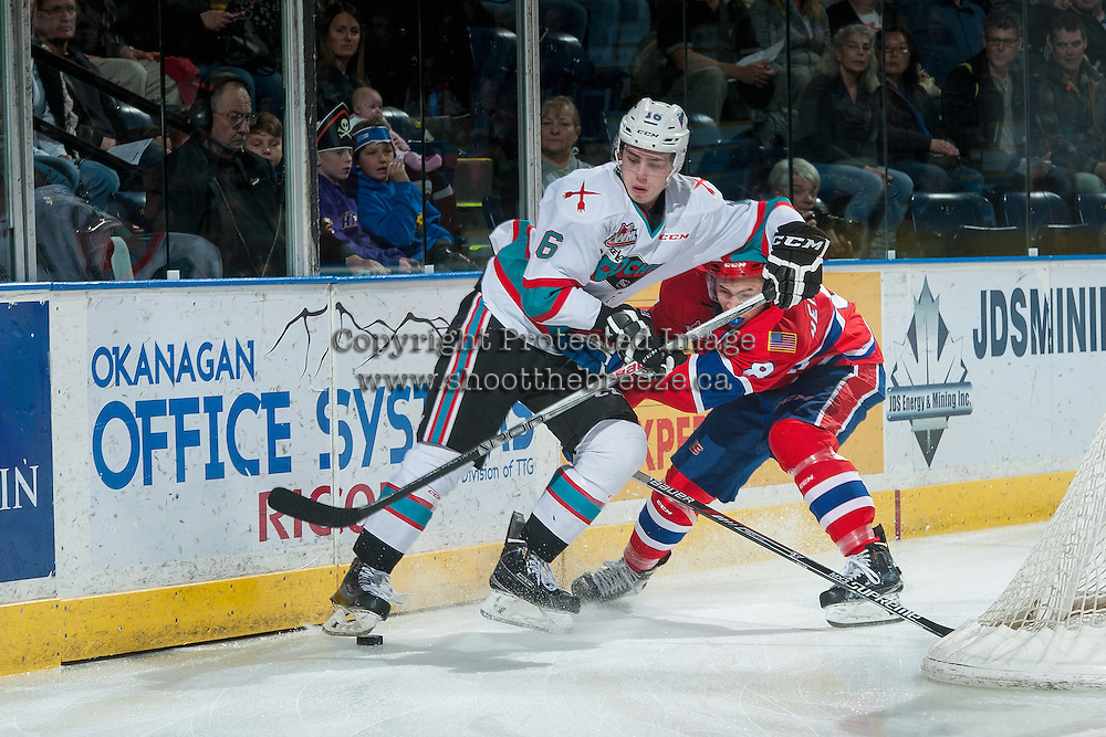 KELOWNA, CANADA - FEBRUARY 27: Jordan Henderson #8 of Spokane Chiefs back checks Kole Lind #16 of Kelowna Rockets during first period on February 27, 2016 at Prospera Place in Kelowna, British Columbia, Canada.  (Photo by Marissa Baecker/Shoot the Breeze)  *** Local Caption *** Kole Lind; Jordan Henderson;