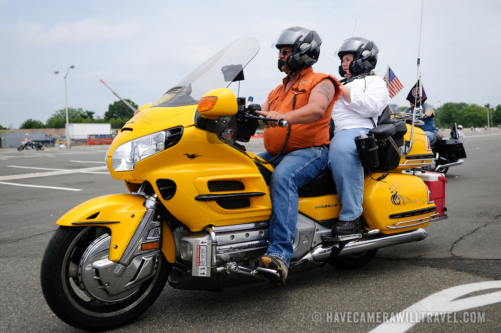 Riders on a bright yellow bike participating in the annual Rolling Thunder motorcycle rally through downtown Washington DC on May 29, 2011. This shot was taken as the riders were leaving the staging area in the Pentagon's north parking lot, where thousands of bikes and riders had gathered.