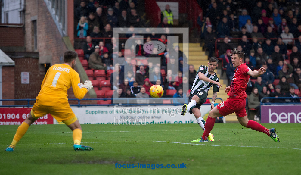 Graham Carey of Plymouth Argyle (centre) shoots at goal during the Sky Bet League 2 match at Bootham Crescent, York<br /> Picture by Russell Hart/Focus Images Ltd 07791 688 420<br /> 14/11/2015