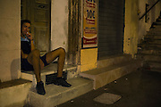 Dealer (18 years) selling  hashish, city center Marseille. ..Marseilles is one of the poorest districs in France, used as a bases for drug traffic on a large scale, leading to murders among groups of competing dealers. 19 people were shot dead in drugs related killings in 2012, mainly with Kalachnikovs...Dealer (18 ans)  de hashish montre une barette a vendre, centre ville marseille. ....Jonge drugsdealer (18 jaar) op zijn verkoopplek in het centrum van Marseille. Hij haalt een omzet van 200 euro per dag.