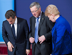 Jean-Claude Juncker, Luxembourg's prime minister, center, Nicolas Sarkozy, France's president, left, and Dalia Grybauskaite, Lithuania's president, right, search for their respective places for the family photo, during the European Summit, in Brussels, on Thursday, March 25, 2010. (Photo © Jock Fistick)