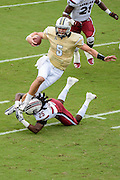 September 28, 2013 - Orlando, FL, U.S: UCF Knights quarterback Blake Bortles (5) leaps over South Carolina Gamecocks safety Kadetrix Marcus (25) for a first down  during 1st half NCAA football game action between the South Carolina Gamecocks and the UCF Knights at Bright House Networks Stadium in Orlando, Fl