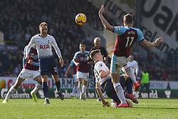 Burnley's Chris Wood (right) clashes with Tottenham Hotspur's Juan Foyth
