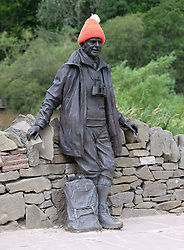 Views of Balmaha, Loch Lomond, Scotland, 31st July 2016<br /> <br /> The statue of broadcaster, writer and climber Tom Weir at Balmaha<br /> <br /> (c) Alex Todd | Edinburgh Elite media