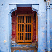 One of Jodhpur, Rajasthan's blue walls a pigeon looks on
