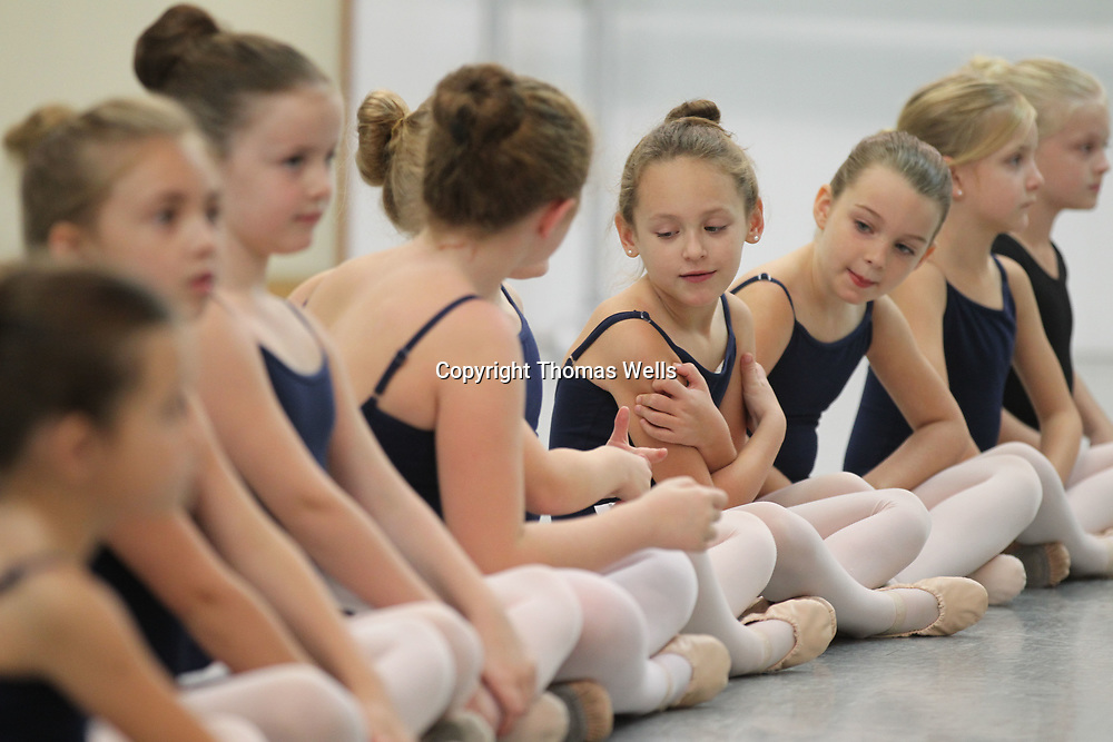 Anna Grace McMath, 7, makes sure she's in the right spot in in line on Sunday for her audition for the Nutcracker.
