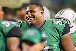 Oct 9, 2015; Huntington, WV, USA; Marshall Thundering Herd defensive lineman Jarquez Samuel (94) is seen on the sidelines after an interception return for a touchdown during the third quarter against the Southern Miss Golden Eagles at Joan C. Edwards Stadium. Mandatory Credit: Ben Queen-USA TODAY Sports