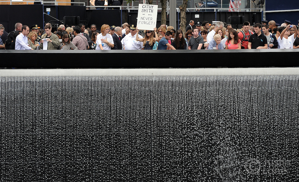 Family members gather at the edge of the North Pool of the 9/11 Memorial during tenth anniversary ceremonies at the site of the World Trade Center September 11, 2011, in New York. POOL/Justin Lane/EPA