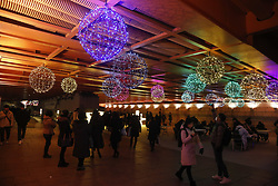 December 18, 2018 - Seoul, South Korea - Visitors enjoy with takes pictures in front of decorations on display to celebrate Christmas and New Year over the Cheonggye Stream in Seoul, South Korea. (Credit Image: © Ryu Seung-Il/ZUMA Wire)
