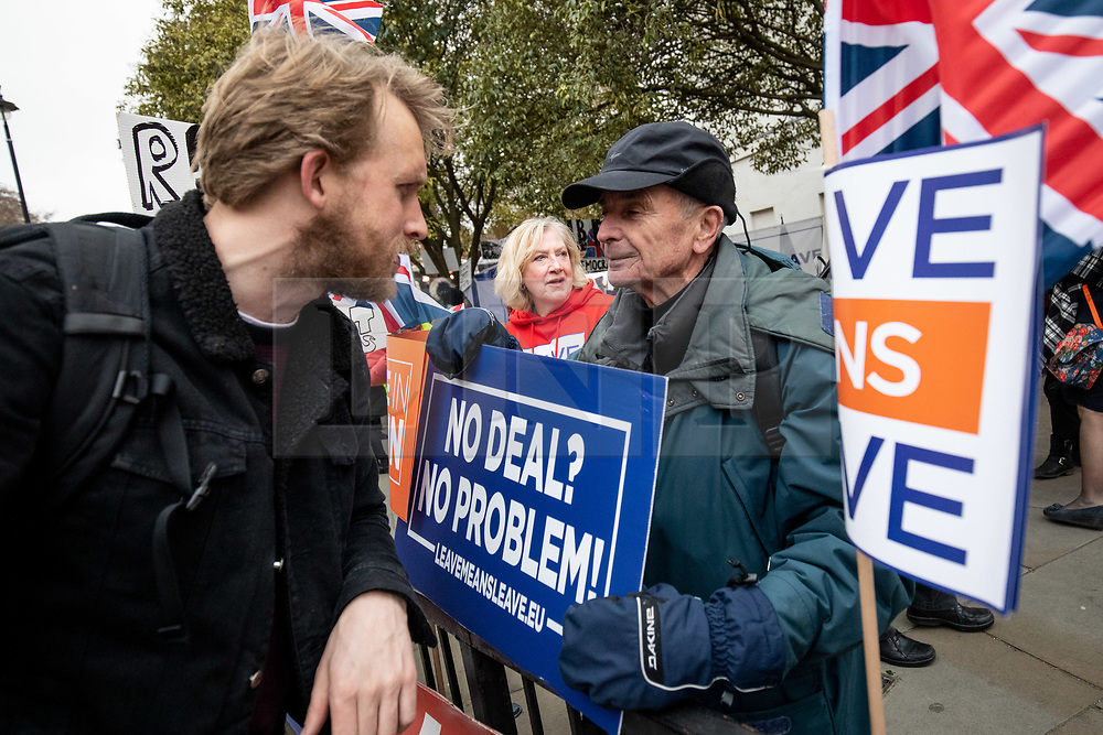 © Licensed to London News Pictures. 15/01/2019. London, UK. A pro-Brexit demonstrators argues with a cyclist during a demonstration outside the Houses of Parliament in Westminster. Today, MPs are due to vote on British Prime Minister Theresa May's EU withdrawal deal, after the previous vote in December was postponed. Photo credit : Tom Nicholson/LNP