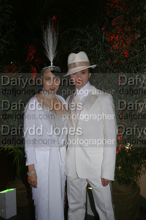 Andy and Patti Wong.  Andy & Patti Wong's Chinese New Year party to celebrate the year of the Rooster held at the Great Eastern Hotel, Liverpool Street, London.29th January 2005. The theme was a night of hedonism in 1920's Shanghai. . ONE TIME USE ONLY - DO NOT ARCHIVE  © Copyright Photograph by Dafydd Jones 66 Stockwell Park Rd. London SW9 0DA Tel 020 7733 0108 www.dafjones.com