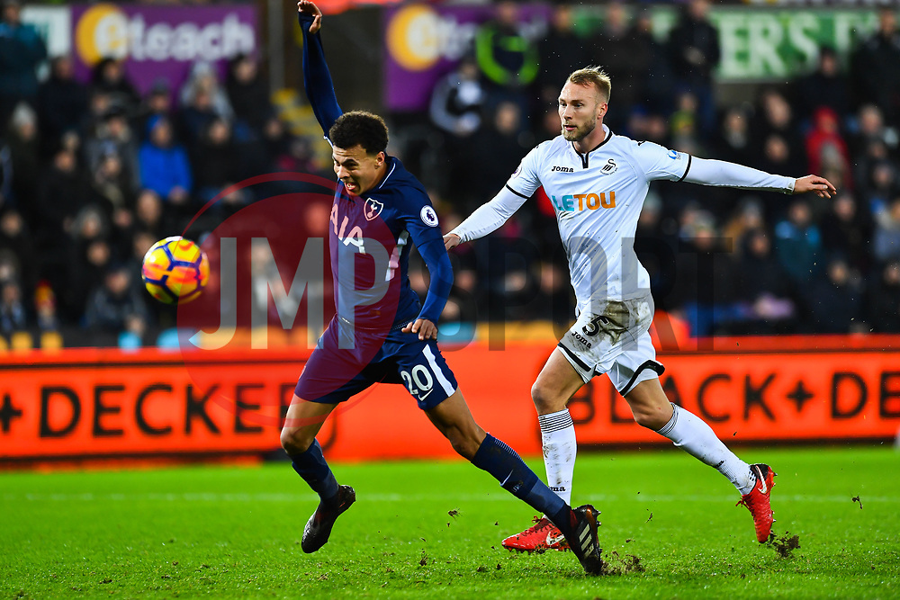Dele Alli of Tottenham Hotspur is fouled by Mike van der Hoorn of Swansea City - Mandatory by-line: Craig Thomas/JMP - 02/01/2018 - FOOTBALL - Liberty Stadium - Swansea, England - Swansea City v Tottenham Hotspur - Premier League