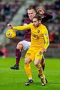 Glenn Whelan (#12) of Heart of Midlothian FC tackles Scott Pittman (#8) of Livingston FC during the Ladbrokes Scottish Premiership match between Heart of Midlothian FC and Livingston FC at Tynecastle Park, Edinburgh, Scotland on 4 December 2019.
