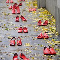 Turin, Italy - November 25, 2016: red shoes united against violence on women  Scarpe rosse: uniti contro la violenza sulle donne