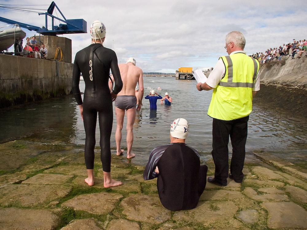 Competitors prepare for the 2005 Dun Laoghaire Harbour Swim, Dun Laoghaire, Co. Dublin, Ireland, August 2005.