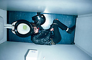 A rock fan with leather jacket and drainpipe jeans, asleep in the toilets, Bristol 1985