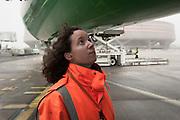 Inspection of an airplane. At Roissy, Nesrine, 34, works as a technical inspector  for the DGCA (Directorate General of Civil Aviation) - she is the only female technical controller at the airport of Roissy-en-France. She can stop a Boeing taking off and make the 300 passengers leave the airplane. Nesrine Chkioua is the only woman controller at Roissy Airport and one of three women doing this job in France.<br /> <br /> <br /> &Agrave; Roissy, Nesrine, 34 ans, exerce le m&eacute;tier de contr&ocirc;leur technique (CTE) pour la DGAC (Direction g&eacute;n&eacute;rale de l&rsquo;aviation civile) - elle est la seule femme contr&ocirc;leur technique &agrave; l&rsquo;a&eacute;roport de Roissy-en-France.  Elle peut immobiliser un Boeing, retarder le d&eacute;collage et m&ecirc;me faire d&eacute;barquer les 300 passagers d&rsquo;un long-courrier. Nesrine Chkioua est la seule contr&ocirc;leur femme &agrave; Roissy a&eacute;roport et est une des trois femmes &agrave; exercer ce m&eacute;tier en France.