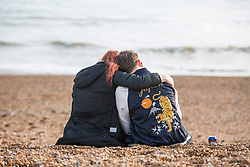 © Licensed to London News Pictures. 13/03/2017. Brighton, UK. Members of the public enjoy the beach in Brighton as sunshine and dry weather hits the seaside resort. Photo credit: Hugo Michiels/LNP