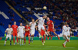 CARDIFF, WALES - Monday, September 9, 2019: Wales' Jonathan Williams (R) challenges for a header with Belarus' Ivan Mayeuski during the International Friendly match between Wales and Belarus at the Cardiff City Stadium. (Pic by David Rawcliffe/Propaganda)