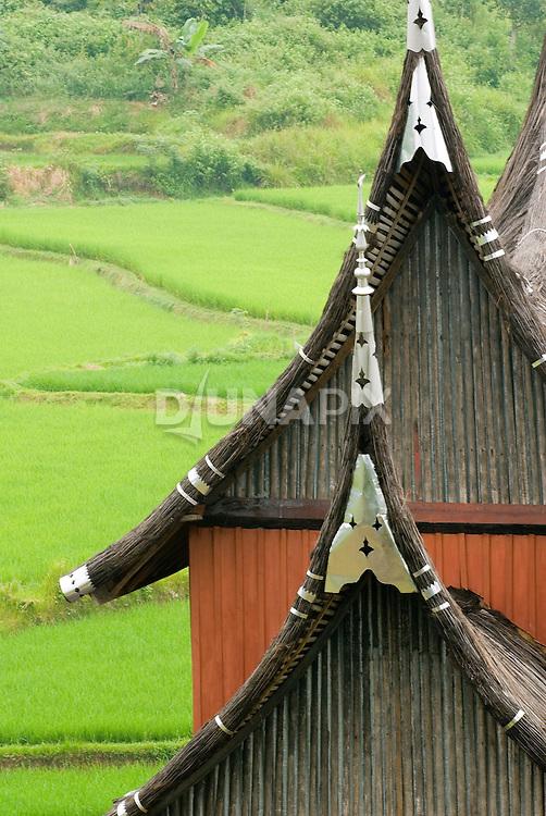 Roof detail of classic Minangkabau-style house behind the Pagaruyung Palace, Batusangkar, West Sumatra.