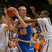 UCLA's Thomas Welsh, center, is doubled teamed by Oregon State's Tres Tinkle, left, and Gary Payton II, right, in the second half of an NCAA college basketball game in Corvallis, Ore., on Wednesday, Jan. 20, 2016. UCLA won 82-73. (AP Photo/Timothy J. Gonzalez)