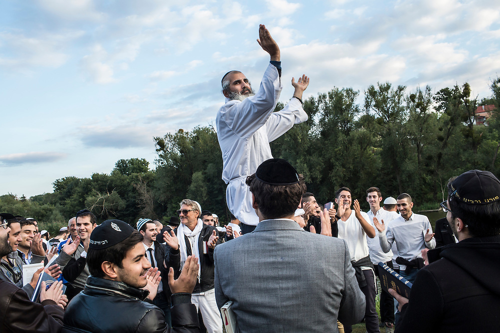 UMAN, UKRAINE - SEPTEMBER 14: Hasidic pilgrims dance not far from the burial site of Rebbe Nachman of Breslov on September 14, 2015 in Uman, Ukraine. Every year, tens of thousands of Hasidim gather for Rosh Hashanah in the city to pray at the holy site. (Photo by Brendan Hoffman/Getty Images) *** Local Caption ***
