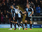 Wycombe midfielder Garry Thompson is congratulated by team mates and celebrates after scoring during the Sky Bet League 2 match between Wycombe Wanderers and Oxford United at Adams Park, High Wycombe, England on 19 December 2015. Photo by David Charbit.
