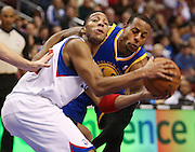 Sixers' Evan Turner charges past Golden State Warriors' Andre Iguodala during the 2nd quarter at the Wells Fargo Center in Philadelphia.