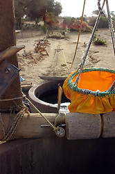 Niger, Agadez, Tidene, 2007. An arrangement of ropes and pulleys enables this water bag to be raised by donkey or camel.