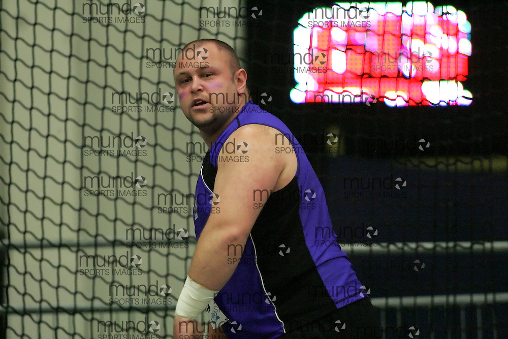 (Windsor, Ontario---13 March 2010) Dan McDonald of University of Western Ontario Mustangs   competes in the men's shot put at the 2010 Canadian Interuniversity Sport Track and Field Championships at the St. Denis Center. Photograph copyright Sean Burges/Mundo Sport Images. www.mundosportimages.com