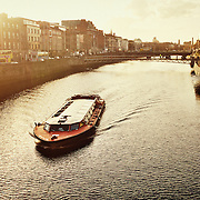 A tourist boat on the river Liffey, in Dublin Ireland