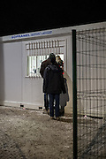 Feb. 23, 2016 - Calais, France - <br /> <br /> Migrant access the temporary reception center where they sleep in contenaires...To enter, they must give their fingerprints to be identified. In Calais, northern France, February 23, 2016<br /> ©Exclusivepix Media
