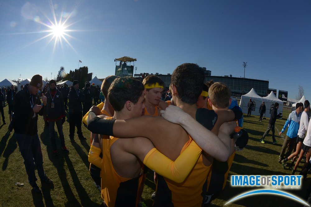 Dec 7, 2013; Portland, OR, USA; Members of the Gig Harbor boys team huddle after winning the team title in the 2013 Nike Cross Nationals at Portland Meadows Race Track.