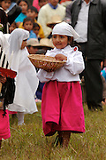A YOUNG LADY HOLDING A BASKET AND WEARING TRADITIONAL CLOTHES AT THE HATUN LUYA FESTIVAL., .   The Hatun Luya is a festival celebrated every september 13th, where everyone from the surrounding areas comes together. During this festivity, you can witness demonstrations of popular customs.