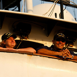 Commanding Officer Cmdr. Teri Jordan (left) and operations officer Lt j.g. Mario Gil (right) look out from the bridge wing as the Coast Guard Cutter Decisive passes near the BP Plc Macondo well site in the Gulf of Mexico off the coast of Louisiana, U.S., on Friday, July 30, 2010. BP Plc continues to work on a relief well to permanently plug the source of the largest oil spill in U.S. history.  Photographer: Derick E. Hingle/Bloomberg