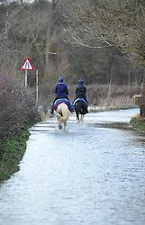 © Licensed to London News Pictures. Date 6 Jan 2014. Ascot Under Wychwood, Oxfordshire. Flooding in Ascott under Wychwood. Road under water. Photo credit : MarkHemsworth/LNP